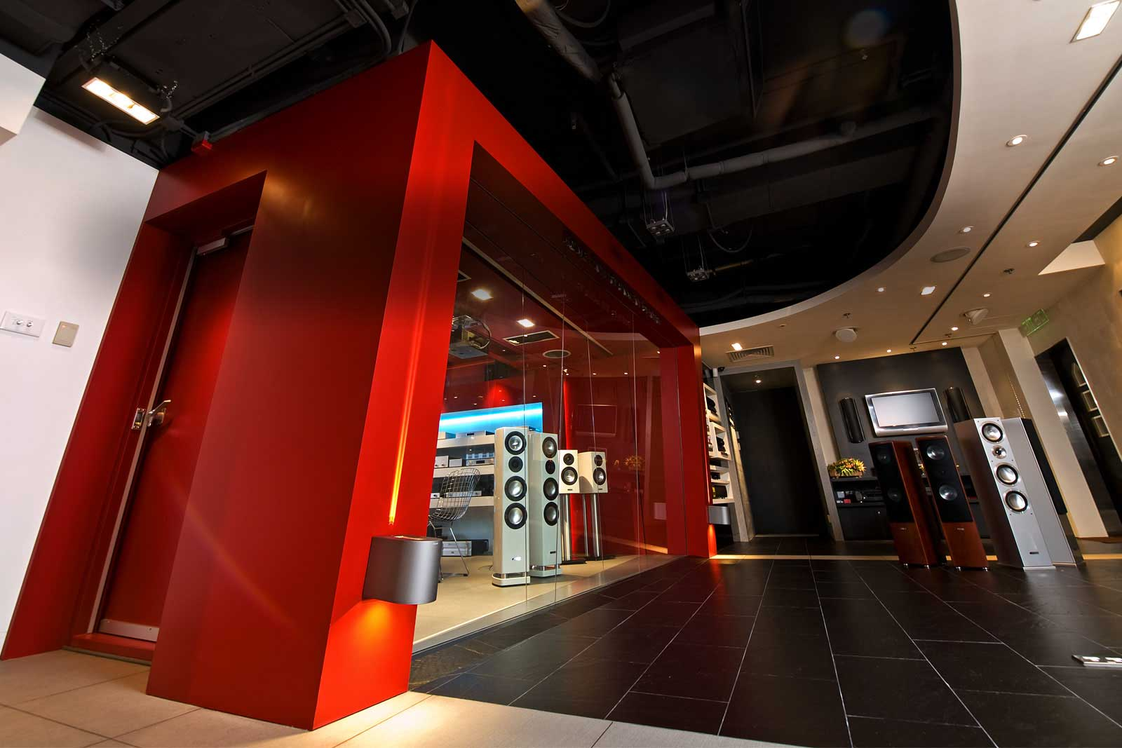 Hardware employed in this room include a projector and motorized acoustically transparent screen, a large LED TV and numerous source equipment as well as in-ceiling surround speakers for customers to experience.  The seating design is flexible to allow the level of authenticity a user shall desire.